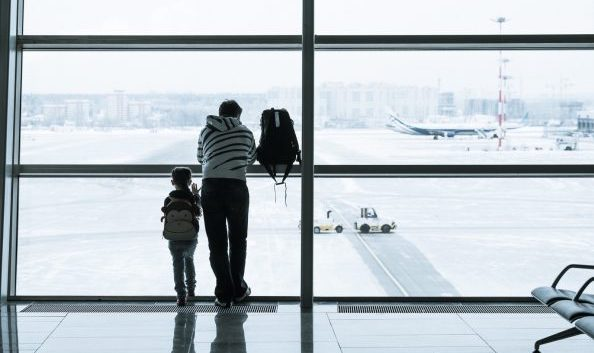 Father and child in airport